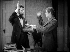 Milt Shanks (Lionel B) is sworn into a secret service by Abraham Lincoln.