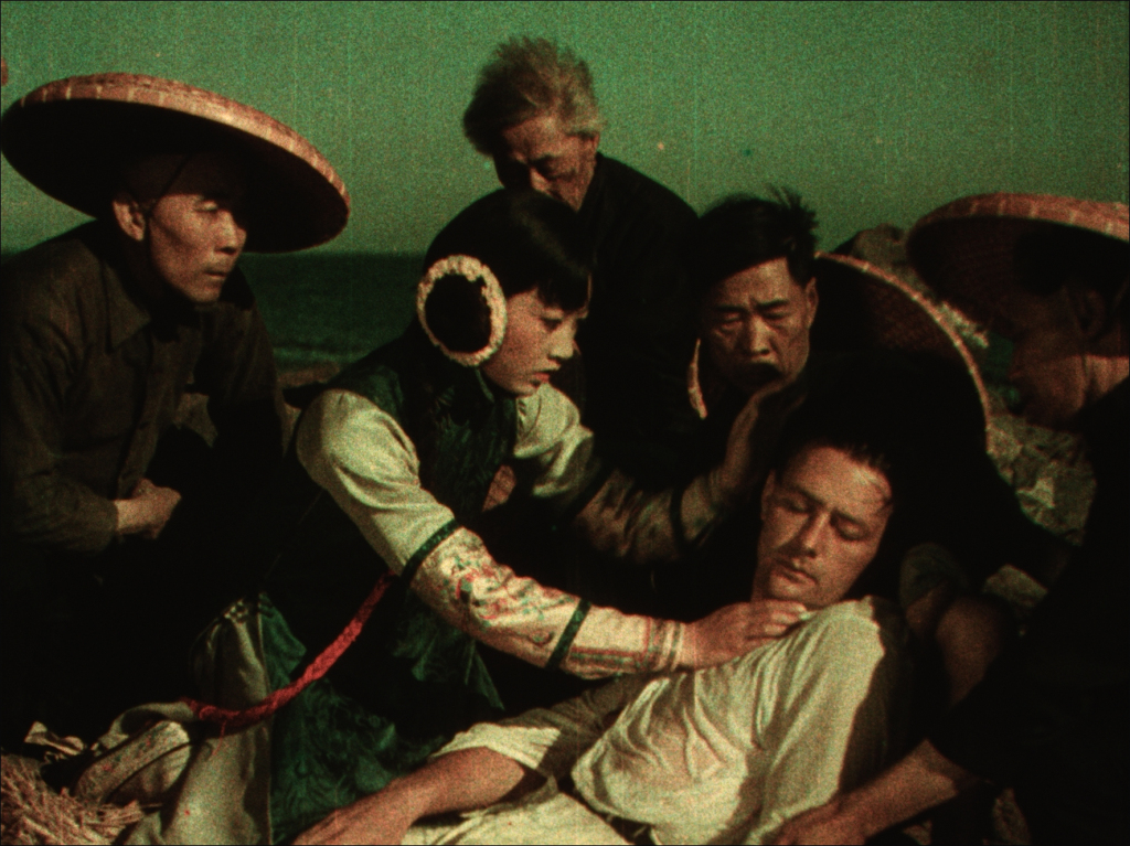 Lotus Flower (Anna May Wong) rescues Allan Carver (Kenneth Harlan) from the Sea.